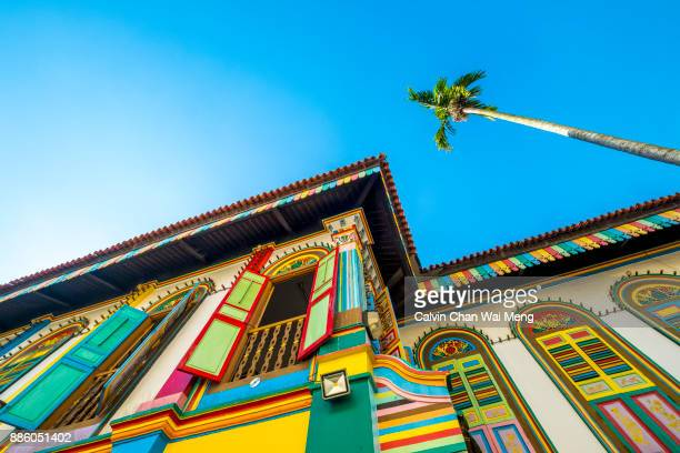 colorful building exterior in little india - singapore - singapore stock photos and pictures
