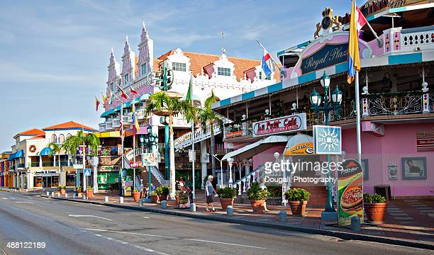 colorful buildings along lloyd g. smith blvd. in oranjestad, aruba - oranjestad stockfoto's en -beelden