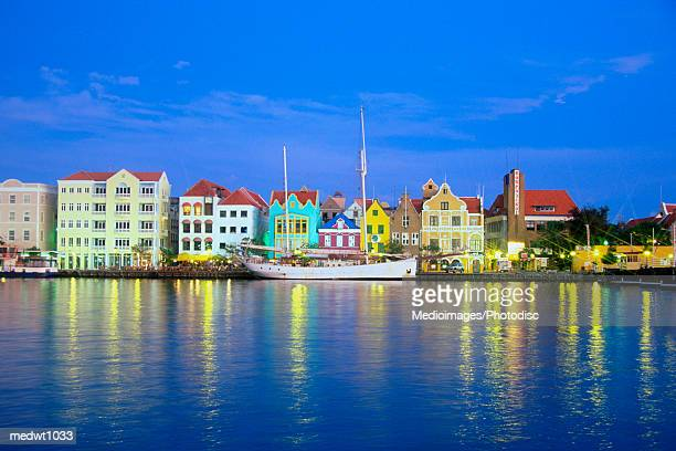 Colorful buildings at night on Willemstad waterfront, Curacao, Caribbean