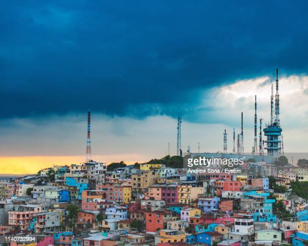Colorful Buildings In City Against Cloudy Sky
