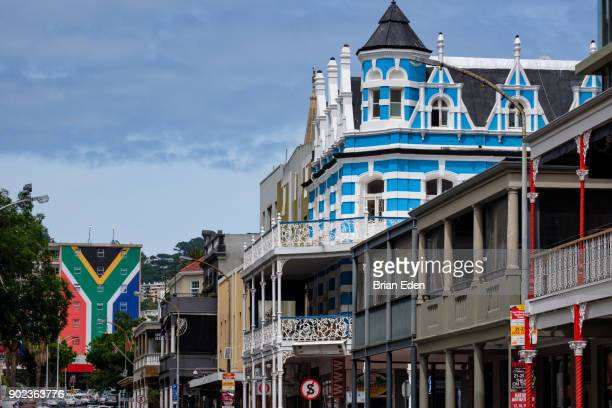 colorful buildings line long street in center city cape town, south africa - south african flag stock photos and pictures