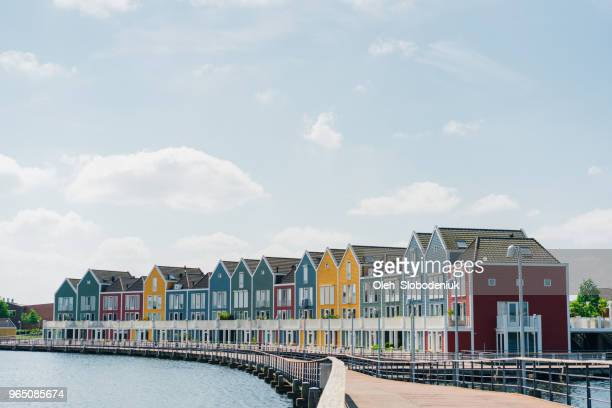 colorful buildings near the lake - rotterdam stock pictures, royalty-free photos & images