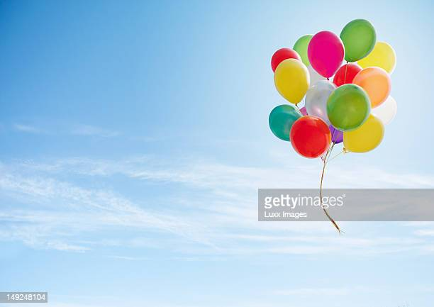 colorful bunch of balloons floating in the sky - bunch stock pictures, royalty-free photos & images