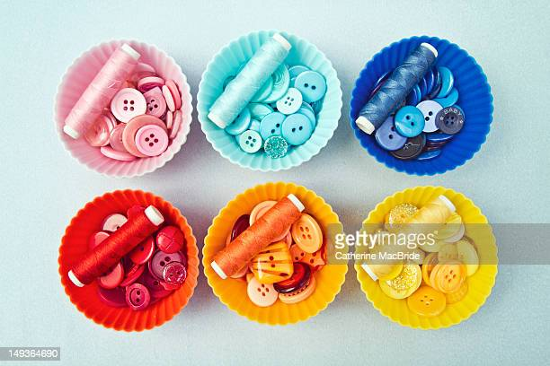 Colorful button filled cupcake cases