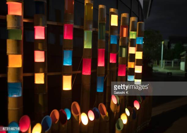 colorful candle lights in bamboo tubes - kanto region stock photos and pictures