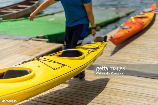 colorful canoes and kayaks by the lake on a sunny day. - istock images stock pictures, royalty-free photos & images