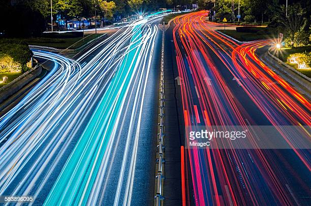 Colorful car lights trail in motion on freeway