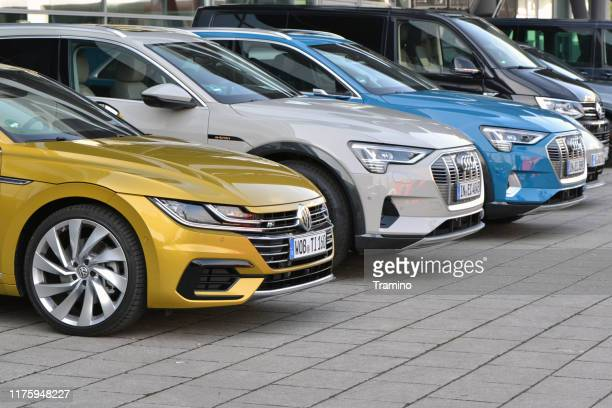 colorful cars on the street - audi stock pictures, royalty-free photos & images