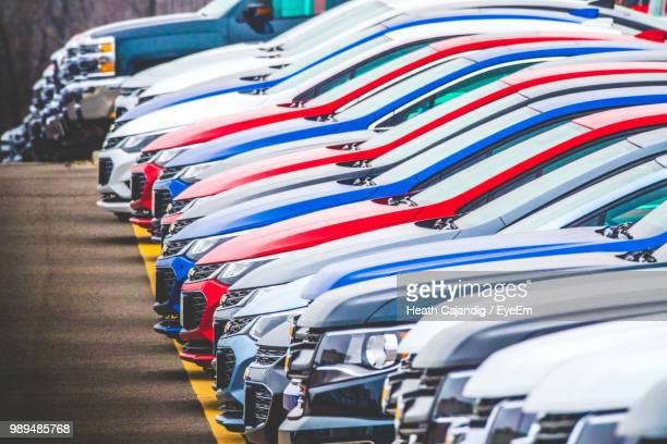 Colorful Cars Parked In Row At Parking Lot
