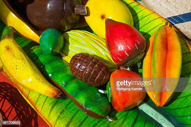Colorful carved wooden fruits for sale in an art market in Iquitos Peru