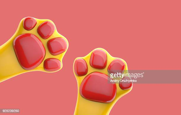 colorful cat's paws on pink background