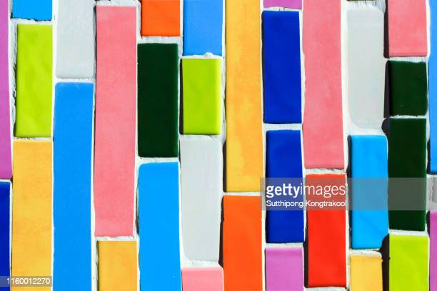 colorful ceramic wall in thai temple. abstract mosaic porcelain ceramic tile background. colored rectangles. - kunstdruck stock-fotos und bilder