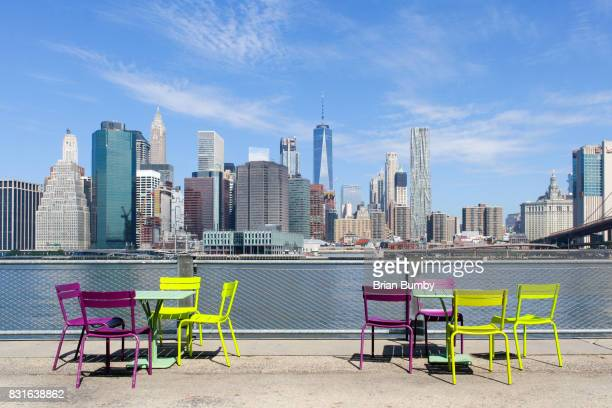 Colorful chairs and tables with view of Manhattan