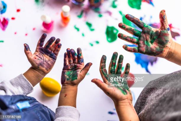 colorful children hands - easter religious stock pictures, royalty-free photos & images