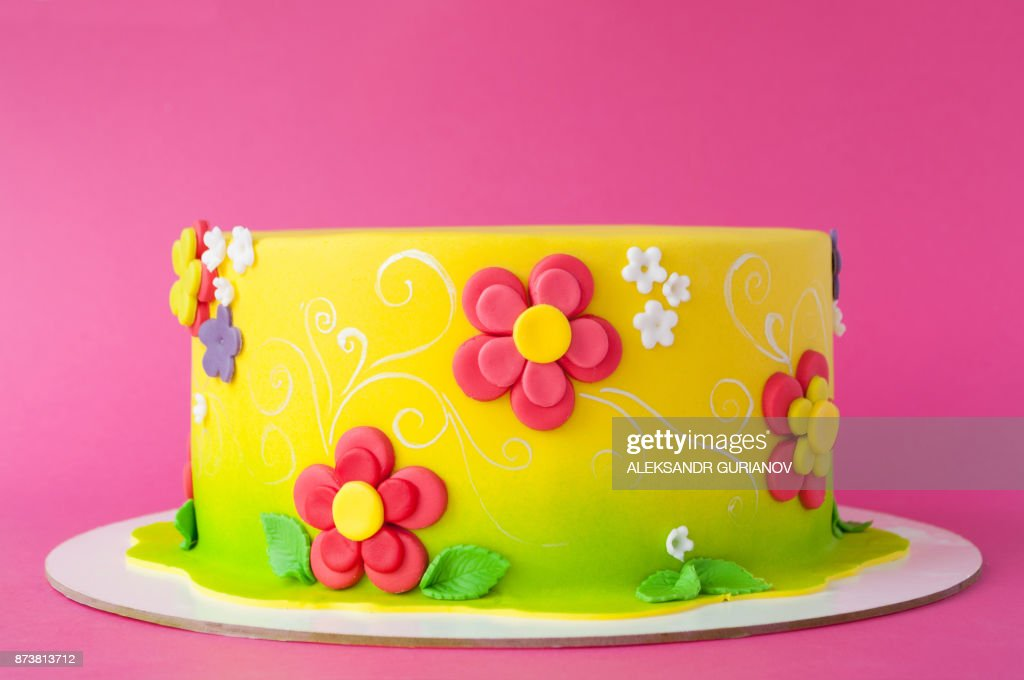 Colorful Childrens Birthday Cake Made Of Yellow Mastic Decorated