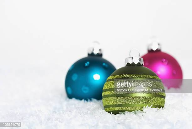 Colorful Christmas balls in the snow