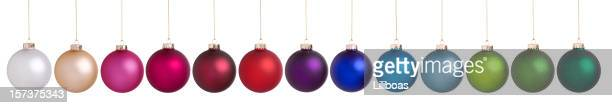 Colorful Christmas Baubles Hanging in a Row Isolated on White.