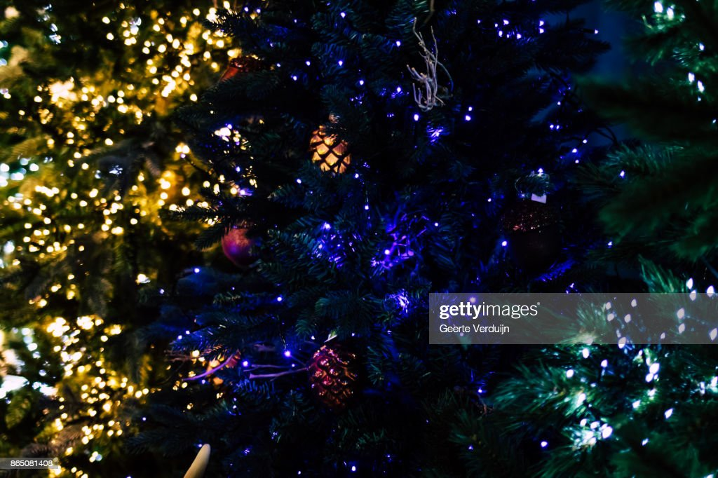 colorful christmas scene with tree lights and pine cone balls stock photo