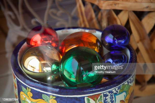 colorful christmas tree balls in a traditional painted mexican crock - timothy hearsum stock pictures, royalty-free photos & images