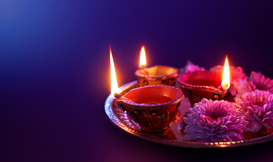 Colorful clay diya lamps lit during diwali celebration with copy space 1162080363