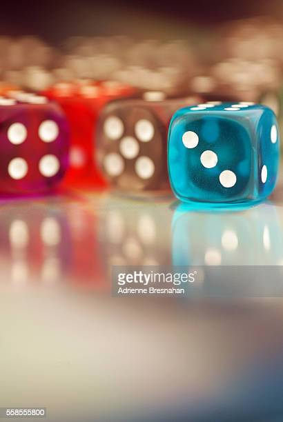 Colorful Clear Dice with Bokeh Background