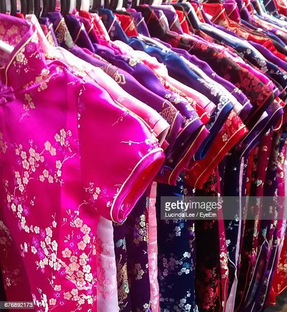 colorful clothes hanging at market for sale - lucinda lee stock photos and pictures