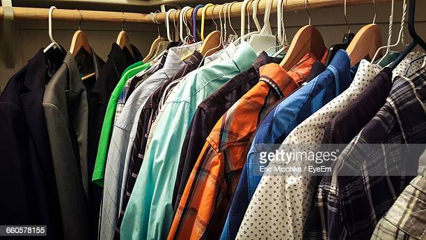 Colorful Clothes Hanging On Rack