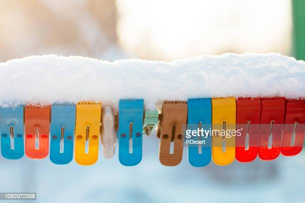 colorful clothespins clothesline covered with snow