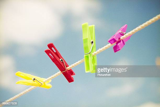 colorful clothespins on clothesline - clothespin stock pictures, royalty-free photos & images