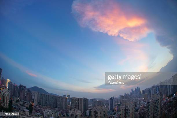 colorful cloud flying over moden city before the typhoon,Shenzhen,China