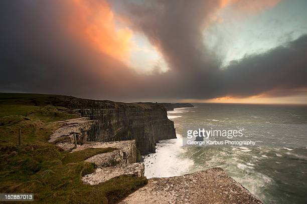 Colorful clouds over coastal cliffs