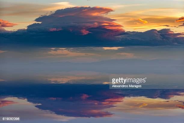 Colorful clouds with reflections at sunset