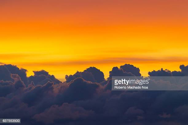 Colorful cloudscape in Winter sunrise. Deep blue and intense orange color contrast