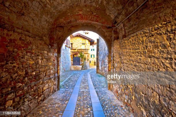 colorful cobbled street of cividale del friuli - ウディネ ストックフォトと画像