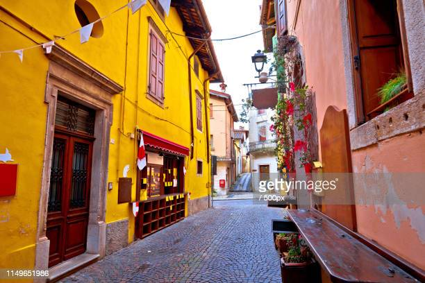 colorful cobbled street of cividale del friuli - acorn street boston stock pictures, royalty-free photos & images
