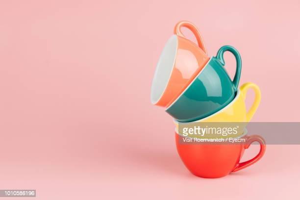 colorful coffee cups over pink background - crockery stock pictures, royalty-free photos & images