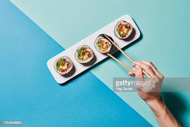 colorful color scheme background and korean gimbap - sushi stock pictures, royalty-free photos & images