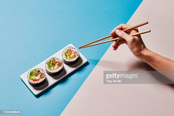 colorful color scheme background and korean gimbap - chopsticks stock pictures, royalty-free photos & images