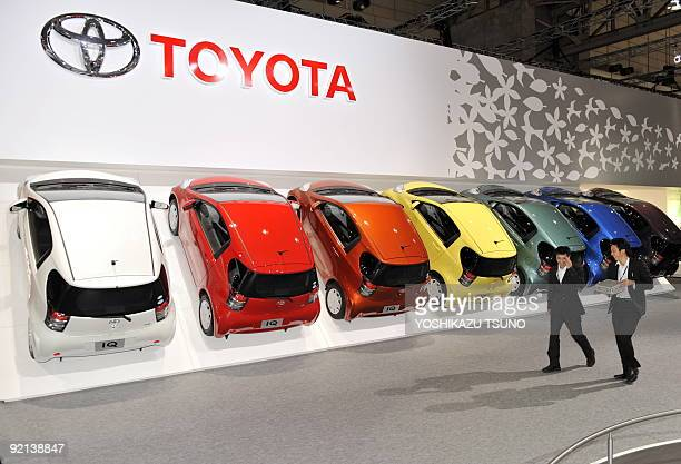 Colorful color variation models of Japanese auto giant Toyota Motor's 'iQ' are displayed at the press preview of the Tokyo Motor Show in Chiba...