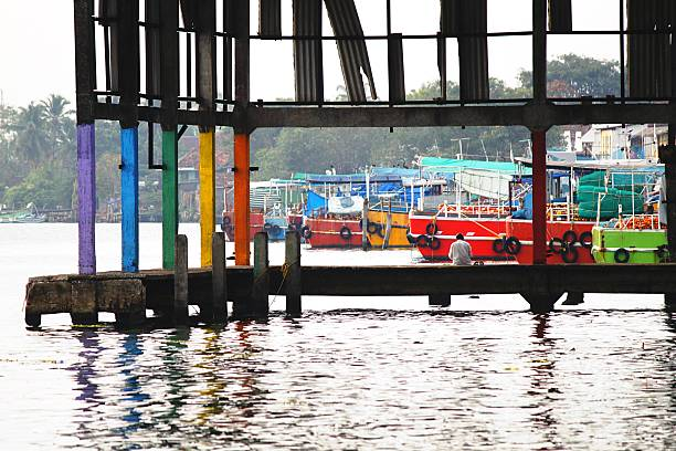 Colorful Columns Of Pier In Marina