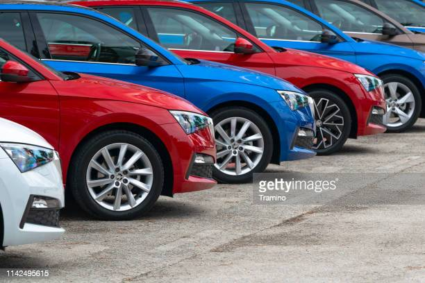 colorful compact cars in a row - new stock pictures, royalty-free photos & images