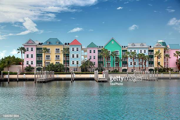 colorful condominiums on the water - nassau stock pictures, royalty-free photos & images
