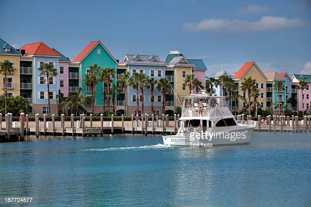 colorful condominiums - nassau stock photos and pictures