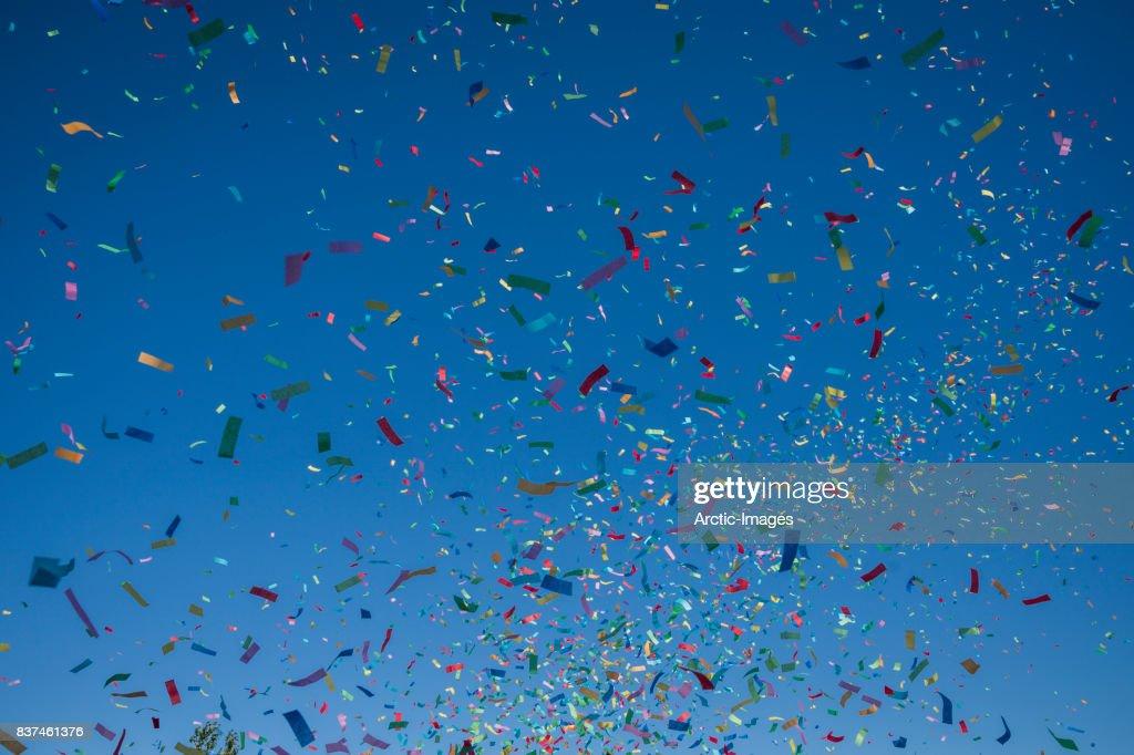 Colorful Confetti against a blue sky : Stock Photo