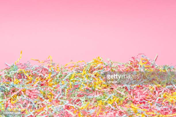 colorful confetti on pink - after party stock-fotos und bilder