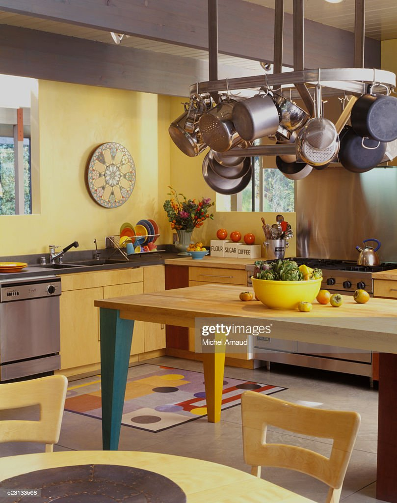 Colorful Contemporary Kitchen With Hanging Pot Rack Stock ...