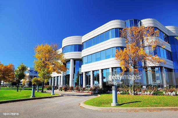 colorful corporate building at fall - medical building stock pictures, royalty-free photos & images
