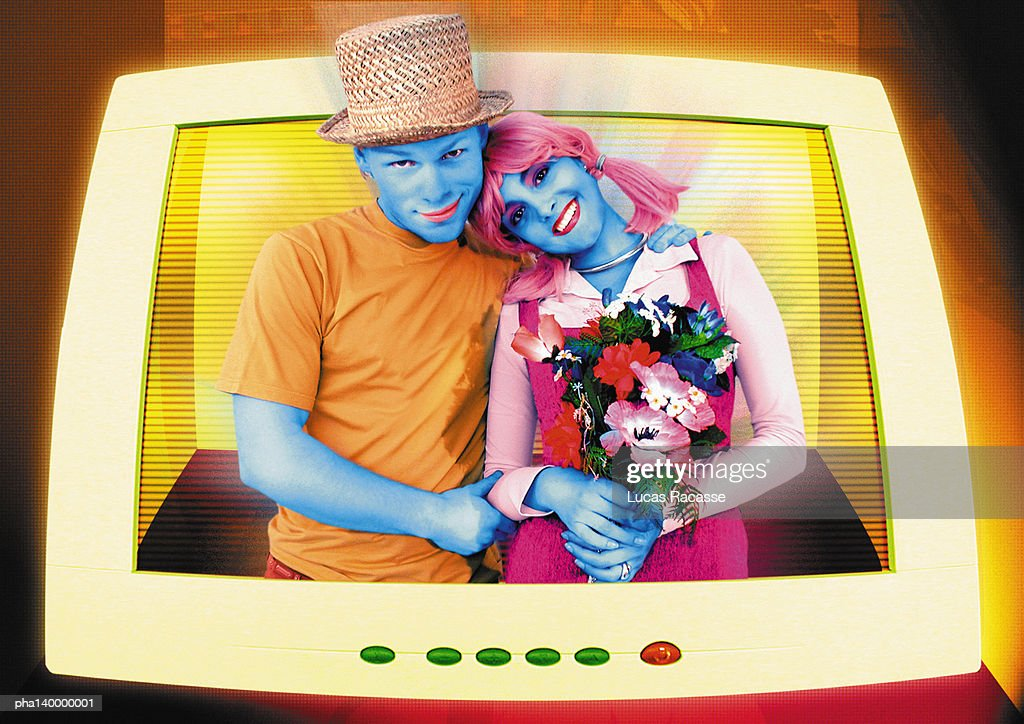 Colorful couple hugging, emerging from computer monitor, woman holding flowers, digital composite. : Stockfoto