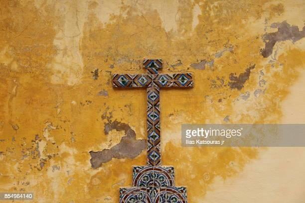 colorful cross on decaying wall of church near sintra, portugal - sintra fotografías e imágenes de stock