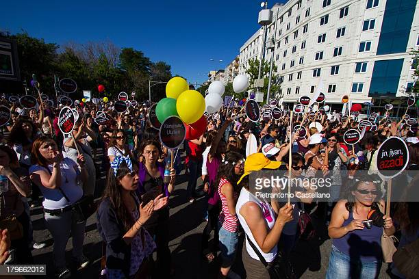 Colorful crowd of women gather in Ankara's Kolej square to protest the announced ban of abortion in Turkey